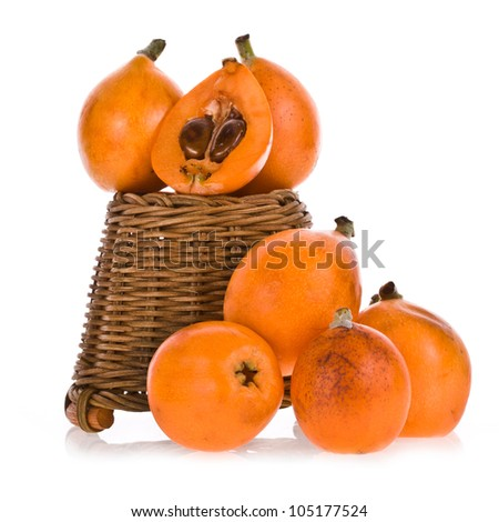 Loquat Medlar fruit in wicker basket isolated on a white background