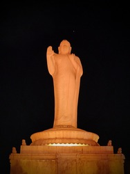 Lord buddha statue at Hussain sagar lake hyderabad, India. Standing colorful Buddha