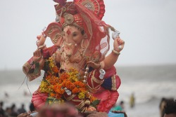 Lord Ganesh on the way to be submerged into the sea by Hindu devotees