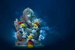 lord ganesha sclupture over dark background. celebrate lord ganesha festival.