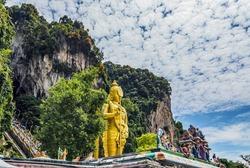 Lord Murugan Statue Batu Caves Kuala Lumpur tourist attraction limestone hill Malaysia