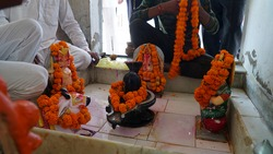 Lord shiva Temple in Village, Wetting shiva linga during a hindu ritual