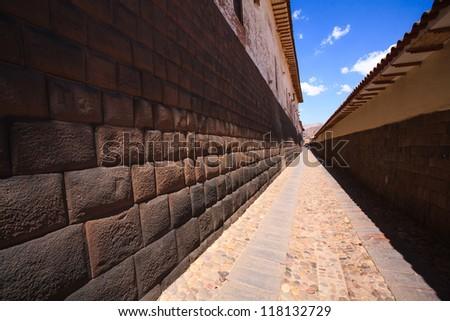 Loreto street, perspective of a Inca foundations in Cuzco, Peru.