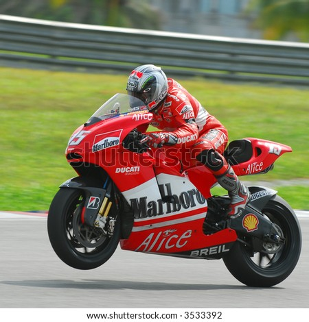 Loris Capirossi exiting a corner in a wheely