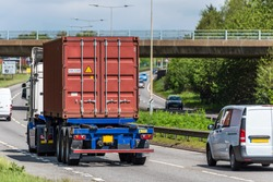 lorry truck with intermodal container on uk motorway in fast motion