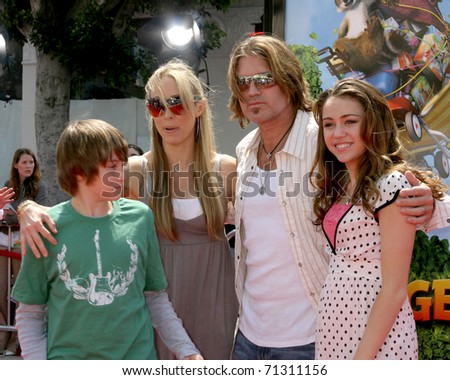 """LOS ANGELES - APR 30:  Billy Ray Cyrus & daughter Miley Cyrus arrive at the """"Over the Hedge"""" LA Premiere at Mann's Village Theater on April 30, 2006 in Westwood, CA"""