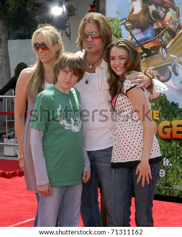 "LOS ANGELES - APR 30:  Billy Ray Cyrus & daughter Miley Cyrus arrive at the ""Over the Hedge"" LA Premiere at Mann's Village Theater on April 30, 2006 in Westwood, CA"