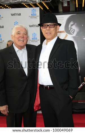 LOS ANGELES - APR 12: G.W. Bailey, Michael Paul Chan at the TCM Classic Film Festival opening night premiere - 40th anniversary restoration of 'Cabaret' on April 12, 2012 in Los Angeles, California
