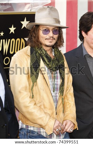 LOS ANGELES - APR 01: Johnny Depp at a ceremony where Penelope Cruz is honored with a star on the Hollywood Walk of Fame on April 1, 2011 in Los Angeles, California.