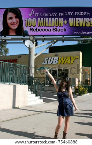 "LOS ANGELES - APR 15:  Rebecca Black  at the unveiling of the digital billboard celebrating ""Friday"" 100 Million Views on YouTube at LaBrea & San Vincente on April 15, 2011 in Los Angeles, CA."