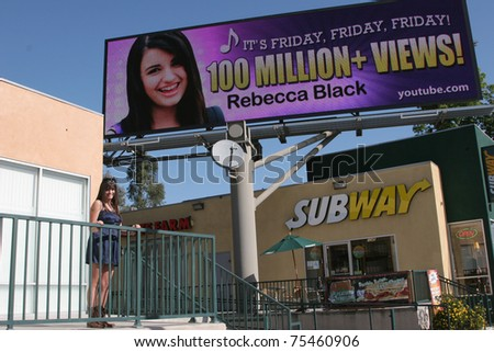 "LOS ANGELES - APR 15:  Rebecca Black  at the unveiling of the digital billboard celebrating ""Friday"" 100 Million Views on YouTube at LaBrea & San Vincente on April 15, 2011 in Los Angeles, CA. - stock photo"