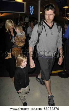 LOS ANGELES-APRIL 8: Actress Tori Spelling with husband Dean and kids at LAX airport. April 8 in Los Angeles, California 2011