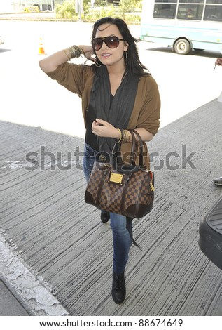 LOS ANGELES-APRIL 15: Singer actress Demi Lovato at LAX airport. April 15 in Los Angeles, California 2011