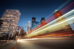 Los Angeles at night. Long exposure shot of blurred bus speeding through night street.