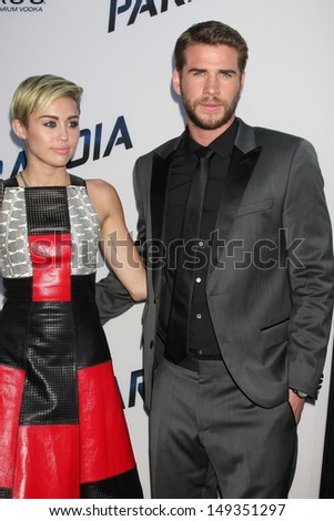 "LOS ANGELES - AUG 8:  Miley Cyrus, Liam Hemsworth arrives at the ""Paranoia"" Los Angeles Premiere at the Directors Guild of America on August 8, 2013 in Los Angeles, CA"