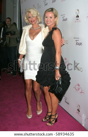 """LOS ANGELES - AUG 10:  Paris Hilton & Amanda Holden arrives at the Paris Hilton's """"Tease"""" Fragrance Launch at My House on August 10, 2010 in Hollywood, CA - stock photo"""