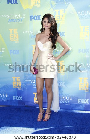 LOS ANGELES - AUG 7: Selena Gomez arrives at the 2011 Teen Choice Awards held at Gibson Amphitheatre on August 7, 2011 in Los Angeles, California - stock photo