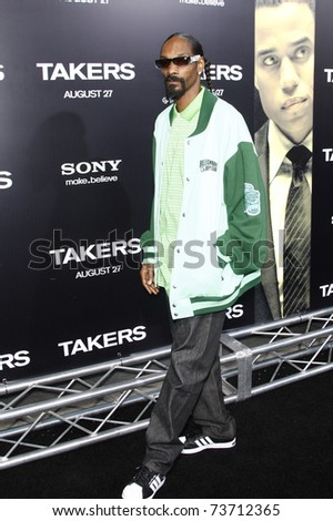 LOS ANGELES - AUG 4:  Snoop Dogg arriving at the premiere of Screen Gems' 'Takers' at the Arclight Cinerama Dome in Los Angeles on August 4, 2010. - stock photo