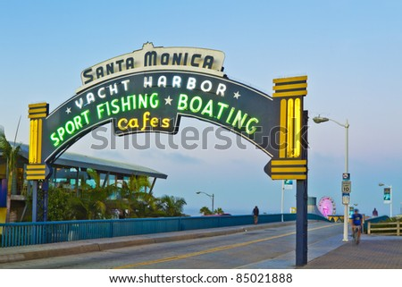 LOS ANGELES - AUGUST 3: Sign welcoming visitors to the Santa Monica pier located in Santa Monica, California on August 3, 2011. The amusement park on the pier is a world-famous tourist attraction.