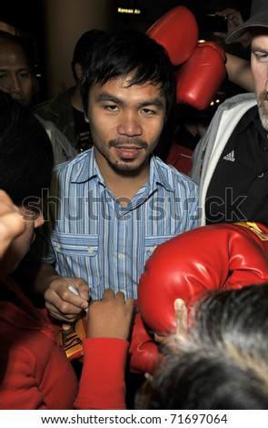 LOS ANGELES - AUGUST 30TH: Boxer Manny Pacquiao is seen at LAX . August 30th 2010 in Los Angeles, California