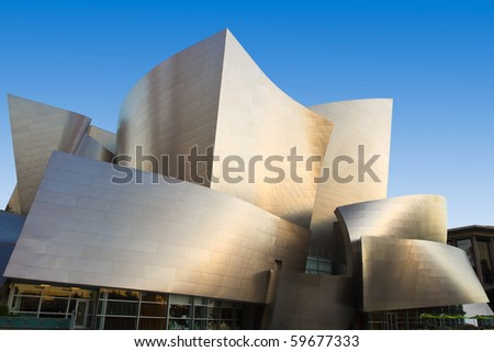 LOS ANGELES - AUGUST 23: The warm morning sun bathes Frank Gehry's modern architectural design of the Walt Disney Concert Center and gives the city of Los Angeles a distinctive skyline. August 23, 2010. - stock photo