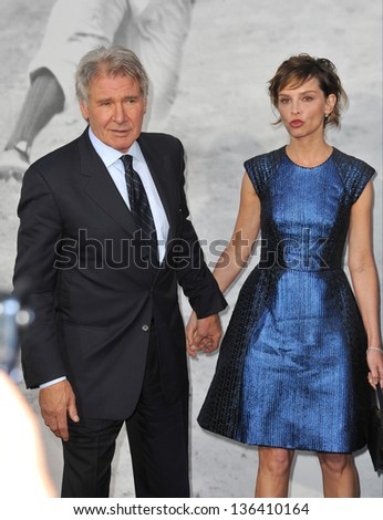 "LOS ANGELES, CA - APRIL 9, 2013: Harrison Ford & wife Calista Flockhart at the Los Angeles premiere of ""42: The True Story of An American Legend"" at the Chinese Theatre, Hollywood. Picture: Jaguar"