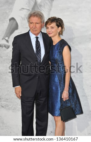 """LOS ANGELES, CA - APRIL 9, 2013: Harrison Ford & wife Calista Flockhart at the Los Angeles premiere of """"42: The True Story of An American Legend"""" at the Chinese Theatre, Hollywood. Picture: Jaguar"""