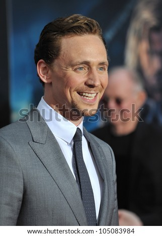 "LOS ANGELES, CA - APRIL 11, 2012: Tom Hiddleston at the world premiere of his new movie ""Marvel's The Avengers"" at the El Capitan Theatre, Hollywood. April 11, 2012  Los Angeles, CA - stock photo"