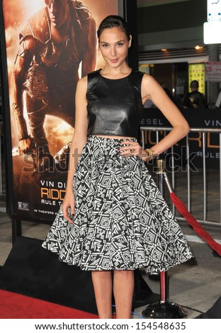"""LOS ANGELES, CA - AUGUST 28, 2013: Gal Gadot at the world premiere of """"Riddick"""" at the Regency Village Theatre, Westwood."""