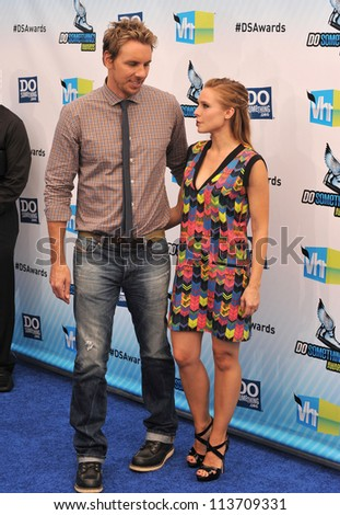 LOS ANGELES, CA - AUGUST 19, 2012: Kristen Bell & Dax Shepard at the 2012 Do Something Awards at Barker Hangar. Santa Monica Airport.