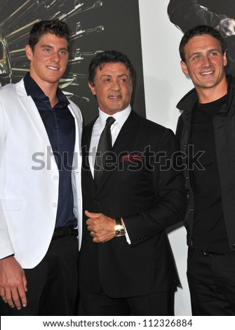 LOS ANGELES, CA - AUGUST 16, 2012: Sylvester Stallone & Olympic gold-medalists Conor Dwyer (left) & Ryan Lochte at the premiere of his movie \