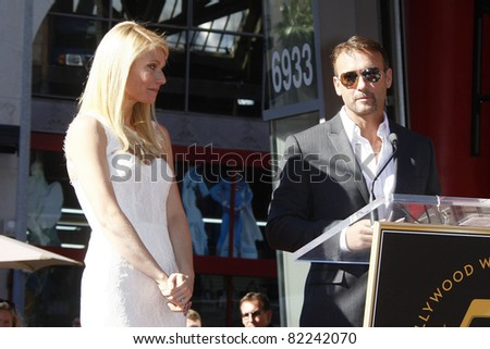 LOS ANGELES, CA - DEC 13: Tim McGraw, Gwyneth Paltrow at a ceremony where Gwyneth Paltrow is honored with a star on the Hollywood Walk of Fame on December 13, 2010 in Los Angeles, California