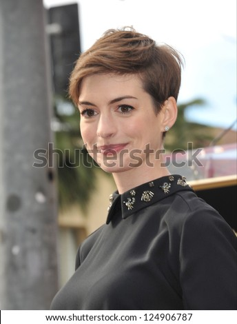LOS ANGELES, CA - DECEMBER 13, 2012: Actress Anne Hathaway on Hollywood Blvd where actor Hugh Jackman was honored with the 2,487th star on the Hollywood Walk of Fame.