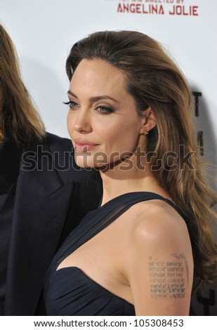 """LOS ANGELES, CA - DECEMBER 8, 2011: Angelina Jolie at the Los Angeles premiere of her new movie """"In The Land of Blood and Honey"""" at the ArcLight Theatre, Hollywood. December 8, 2011  Los Angeles, CA - stock photo"""