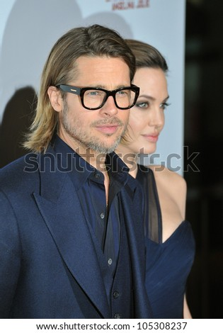 """LOS ANGELES, CA - DECEMBER 8, 2011: Brad Pitt & Angelina Jolie at the premiere of """"In The Land of Blood and Honey"""" at the ArcLight Theatre, Hollywood. December 8, 2011  Los Angeles, CA - stock photo"""
