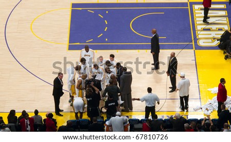 LOS ANGELES, CA. – DECEMBER 25: Players in Huddle with Coach Phil Jackson during Christmas Day NBA Game L.A. Lakers versus the Miami Heat at Staples Center. on December 25, 2010 in Los Angeles. - stock photo