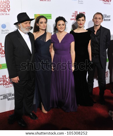 LOS ANGELES, CA - DECEMBER 8, 2011: Rade Serbedzija, Angelina Jolie, Vanesa Glodjo, Zana Marjanovic & Goran Kostic at the premiere of In The Land of Blood and Honey December 8, 2011  Los Angeles, CA - stock photo