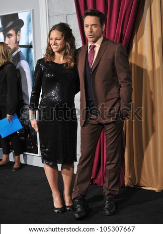 "LOS ANGELES, CA - DECEMBER 6, 2011: Robert Downey Jr. & wife Susan Downey at the premiere of ""Sherlock Holmes: A Game of Shadows"" at the Village Theatre, Westwood. December 6, 2011  Los Angeles, CA"
