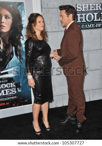 """LOS ANGELES, CA - DECEMBER 6, 2011: Robert Downey Jr. & wife Susan Downey at the premiere of """"Sherlock Holmes: A Game of Shadows"""" at the Village Theatre, Westwood. December 6, 2011  Los Angeles, CA"""