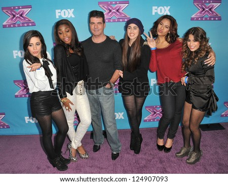 "LOS ANGELES, CA - DECEMBER 17, 2012: Simon Cowell & Fifth Harmony at the press conference for the season finale of Fox's ""The X Factor"" at CBS Televison City, Los Angeles."