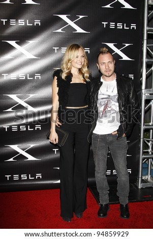 LOS ANGELES, CA - FEB 9: Malin Akerman; Roberto Zincone at the Tesla Worldwide Debut of Model X on February 9, 2012 in Hawthorne, Los Angeles, California