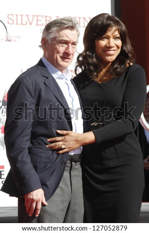 LOS ANGELES, CA - FEB 4: Robert De Niro, wife Grace Hightower at a ceremony where Robert De Niro is honored with hand and foot prints at TCL Chinese Theater on February 4, 2013 in Los Angeles, CA - stock photo