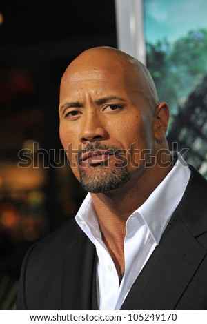 """LOS ANGELES, CA - FEBRUARY 2, 2012: Dwayne Johnson, aka """"The Rock"""", at the premiere of his new movie """"Journey 2: The Mysterious Island"""" at Grauman's Chinese Theatre. February 2, 2012  Los Angeles, CA"""