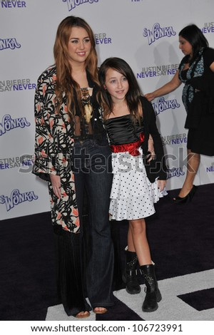 "LOS ANGELES, CA - FEBRUARY 8, 2011: Miley Cyrus & sister Noah Cyrus at the Los Angeles premiere of ""Justin Bieber: Never Say Never"" at the Nokia Theatre LA Live. February 8, 2011  Los Angeles, CA"