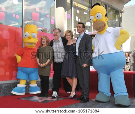 "LOS ANGELES, CA - FEBRUARY 14, 2012: ""The Simpsons"" creator Matt Groening with Nancy Cartwright (left), Yeardley Smith & Hank Azaria on Hollywood Boulevard February 14, 2012  Los Angeles, CA"