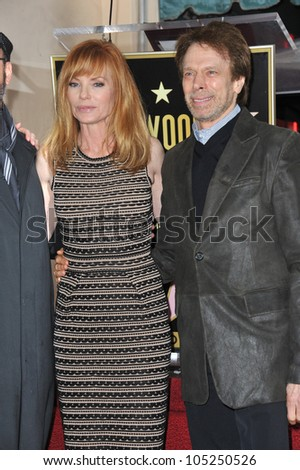 LOS ANGELES, CA - JANUARY 23, 2012: Marg Helgenberger with producer Jerry Bruckheimer on Hollywood Boulevard where she received a star on the Hollywood Walk of Fame. January 23, 2012  Los Angeles, CA