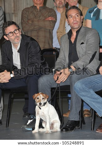 LOS ANGELES, CA - JANUARY 31, 2012: The Artist director Michel Hazanavicius & stars Jean DuJardin & Uggie on Stage 5 at Red Studios in Hollywood. January 31, 2012  Los Angeles, CA
