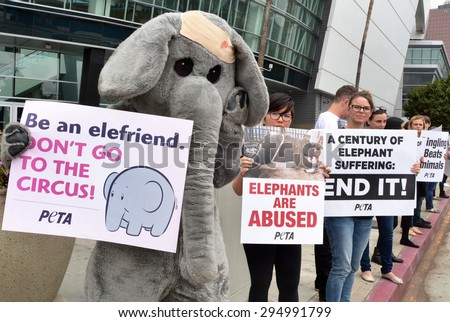 LOS ANGELES, CA â?? JULY 9, 2015: A protestor in an elephant costume joins other activists holding signs denouncing animal treatment by Ringling Bros. Circus on July 9, 2015 in Los Angeles, California.