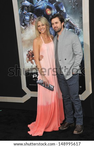 LOS ANGELES, CA - JULY 9, 2013: Rob McElhenney & Kaitlin Olson at the premiere of Pacific Rim at the Dolby Theatre, Hollywood.