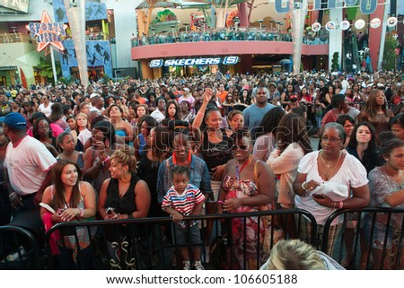 """LOS ANGELES, CA - JUNE 29: Fans show up to the Tyrese concert held at the """"5 Towers,"""" a state-of-the art concert venue at Universal Studios' CityWalk on June 29, 2012 in Los Angeles, CA. - stock photo"""